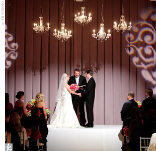 Gobo lighting and chandeliers played a key role in creating the dramatic ambience Jenny and Travis wanted for their ceremony, which included verses that the couple had hand-picked.