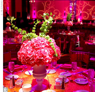 Dramatic lighting transformed the ballroom into a warm, romantic space. The signature swirl motif covered the walls, while LED lights showcased the centerpieces.