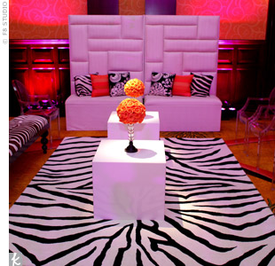 A leather couch, funky, graphic pillows and a zebra-print rug turned part of the reception space into a hip lounge area.