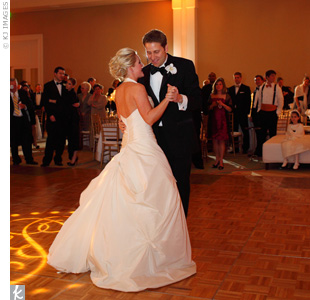 "The couple chose a modern tune for their first dance:  Jason Mraz's ""I'm Yours."""