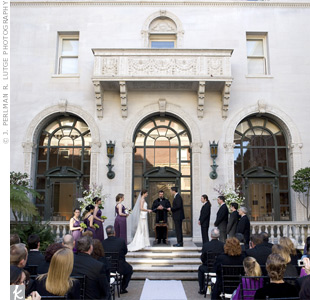 The mid-afternoon ceremony took place in the tiled courtyard outside the reception site. Marble walls on three sides meant the couple needed little additional décor beyond a white aisle runner.