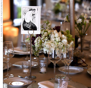 Tables were topped with tall, pewter candelabras overflowing with hydrangeas and ostrich feathers for some drama. Smaller arrangements of similar blooms were found at the base of each centerpiece.