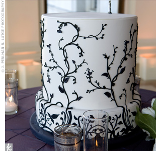 The non-traditional cake took an architectural, column shape and featured black flowering branches on a white background, a design characteristic of the fin de siecle era.