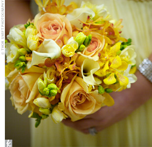 The bridesmaids carried similar flowers to the bride, including roses, orchids, and calla lilies. The spring-like bouquets paired well with their butter-yellow dresses.