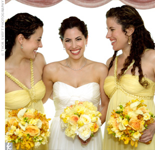 The pale-yellow dress that the bridesmaids wore had an empire waist and was made of flowing chiffon for a Grecian look.