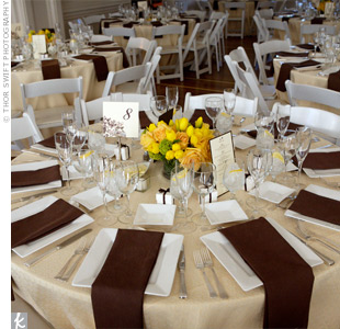Square dinner plates contrasted with the round tables, which were covered with pale- yellow linens. Folded brown napkins hung over the table edge, creating a striped effect.