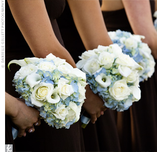 Pale-blue hydrangeas accented with white roses and mini calla lilies created the full, round look that Leah was going for.