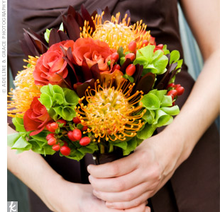 Each maid carried a colorful fall bouquet of pincushion proteas, roses, and bells of Ireland, all tied with brown ribbon to match the dresses.