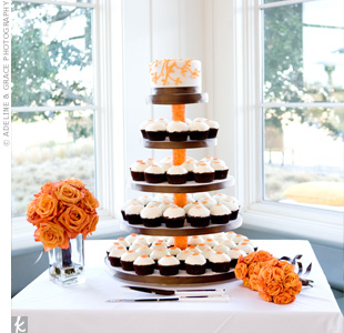 Several flavors of cupcakes were presented on a multi-tiered display. In a nod to tradition, there was a cake for cutting at the top with a design similar to the invites.