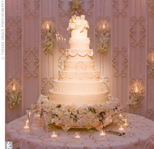 The damask-style monogram decorated the center layer of the seven-tiered, buttercream-frosted cake. A coordinating backdrop and a bed of flowers added even more drama to the elaborate display.