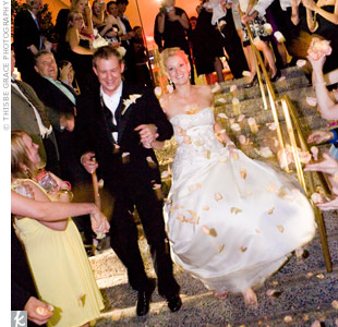 "Guests threw rose petals as the couple walked out of the reception -- at 1 a.m.! ""I think if the band would've kept playing, we would've stayed even later!"" says Nicole."
