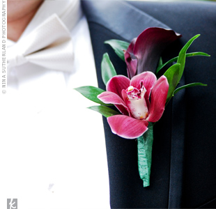 A plum calla lily was paired with a deep pink cymbidium orchid to jazz up the groom's lapel.
