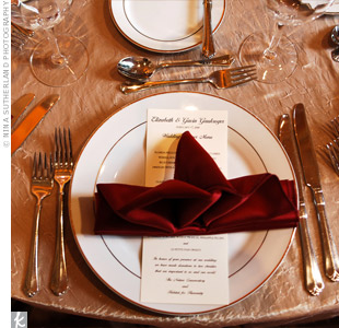 Artfully folded napkins were placed horizontally over on the rectangular menu cards, forming a decorative cross-shape.