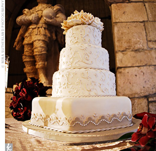 A hexagonal base supported three round tiers of the vanilla rum cake,which was layered with tropical pineapple filling, frosted in buttercream and covered with fondant. The intricate decorative design echoed the shape and style of the cloisters.