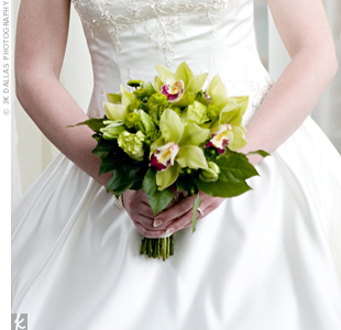 As a vibrant contrast to her bridesmaids' orange flowers, Courtney carried a bouquet of green cymbidium orchids, spider mums, poms and green parrot tulips.