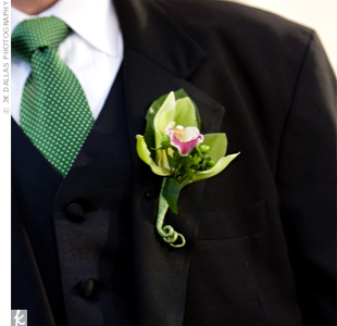 To follow the green in the color scheme and match the bouquets, Josh donned a single, green cymbidium orchid on his lapel.
