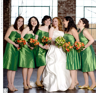 Courtney wanted her bridesmaids to have a say in their dress style, so she let them choose from a variety of leaf green, silk shantung designs. The ladies all wore gold shoes and carried vibrant orange bouquets.