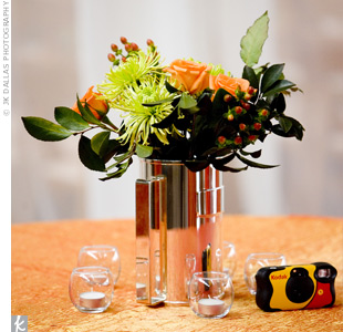 The centerpieces followed the orange-and-green color scheme with silver pitchers filled with orange roses, spider mums and green poms. Bright orange linens covered the tables with a hint of metallic sheen.