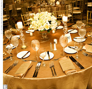 Three kinds of centerpieces served as focal points on each table, and included glass compote dishes filled with roses, dendrobium orchids, calla lilies and white hydrangeas. Lots of flickering candles surrounded each arrangement for a romantic effect.