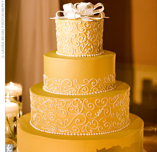 The buttercream scrolled icing on the cake perfectly matched the gold-colored linens on the reception tables.