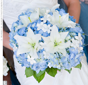 "Heidi carried a lovely bouquet of blue and cream hydrangeas, large white lilies and pearl-accented stephanotis. ""I loved the look of the hydrangeas, and I love the smell of lilies, so the combination just seemed perfect,"" she says."