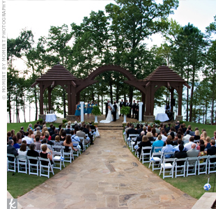 Heidi and Beau exchanged vows in the Summer House Garden under a three-tiered gazebo facing Lake Lanier. Guests sat on white chairs along a stone pathway that served as the aisle.
