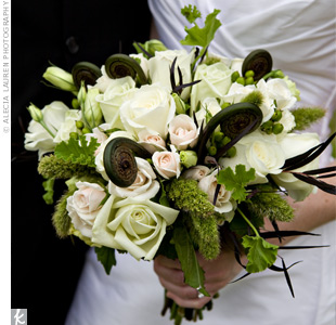 Katie carried an elegant and earthy bouquet of green and white mini hydrangeas, roses, lisianthus, geranium foliage, hypericum berries and fern curls.
