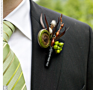 The groom wore a masculine arrangement of green hypericum berries, fern curls and pussy willow tips on his lapel.