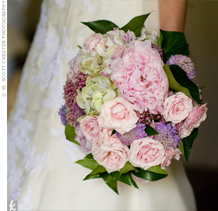 Lauren had two bouquets. During the ceremony, she carried a white bouquet, but for the rest of the day she held a romantic arrangement of purple and pink blooms, reflecting the pastel shades of the wedding day.