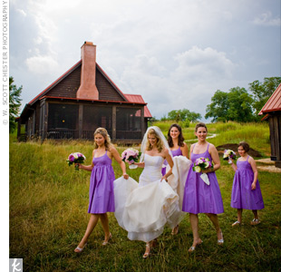 Lauren&#39;s bridesmaids wore rich purple baby doll dresses with pockets and empire waists. They accessorized their look with strappy, silver shoes and romantic, round bouquets of purple and white peonies.