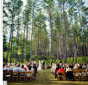 A serene lake and wooded hillside set the scene for Lauren's and Dylan's ceremony. They exchanged vows in a traditional Jewish ceremony, beneath a huppah of flowers and green vines.