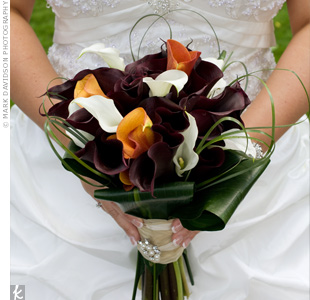 Jennifer's florist created a calla lily bouquet for her and gave Robert a coordinating boutonniere: a single plum calla lily.