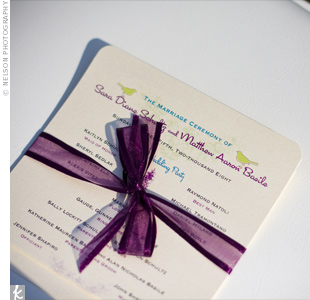 Single-page programs made out of white cardstock and decorated with purple and black details rested on each chair. Ribbons added a pop of color.