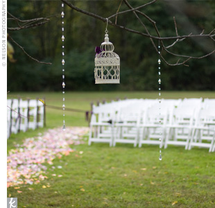 Bundles of veronica tied with ribbon decorated the sides of wooden chairs lining the aisle.