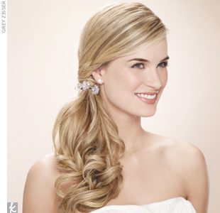Curl your strands to add volume and wrap them with a few embellished hair ties for a polished look with lots of style. 