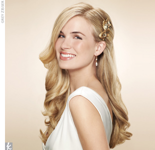 Glam it up with a gilded comb; tuck strands behind your ear for a chic look.