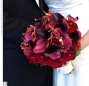 Mokara orchids were exotic additions to the classic fall grouping of mini calla lilies and roses. Scattered crystals made the bouquet sparkle.