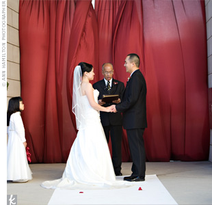 The couple exchanged vows in the Bamboo Garden at San Jose City Hall. The couple stood out against the ruby-red drapery they used as a backdrop.