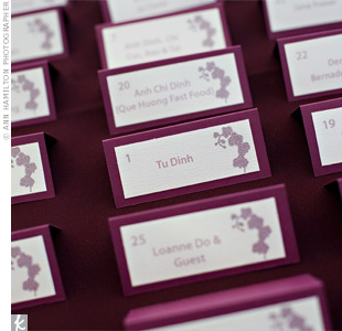 The same orchid design used on the invites added some flair to the tented escort cards. The layered look made for sophisticated stationery.