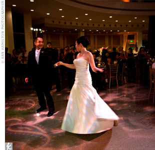 "Under paisley gobo lighting that added texture to the dance floor, the couple twirled to ""Spend My Life With You,"" by Eric Benet and Tamia."