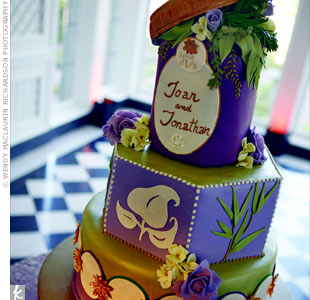 Each tier of the spice-themed, fondant-frosted cake was a different shape and had a different design, with the top layer showing off the logo that appeared on the stationery.