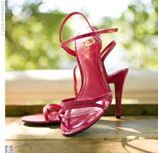 Hot-pink, strappy sandals matched the maids' dresses and added a pop of color underneath Andrea's gown.