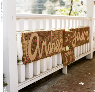 To personalize the front porch of the venue, the couple hung a sign with their names and wedding date. Like many of the other decorations, a friend made this for them.