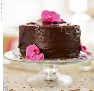The couple's friend baked a cake in Jason's favorite flavor—chocolate! Hot-pink orchids worked the signature hue into the dessert display.