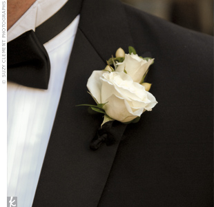 Groomsmen wore roses and hypericum berries on their lapels. The creamy flowers matched the other floral arrangements.