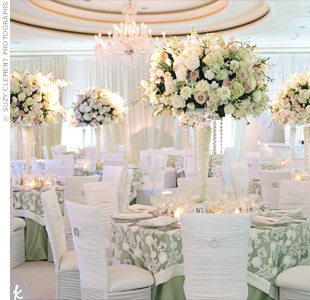 Strands of crystals added bling to hydrangeas, roses and other cream, pink and green flowers. Votives at the base upped the romance at the tables.