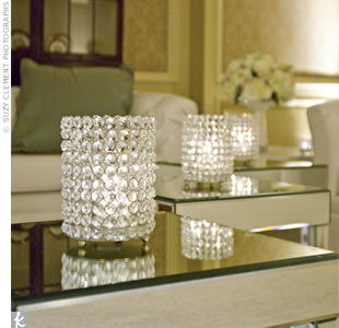 Crystal votive holders were placed on mirrored coffee tables throughout the cocktail lounge for maximum sparkle.