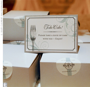 Guests grabbed slices of leftover cake on their way out. Stickers with the couple's monogram sealed the boxes.