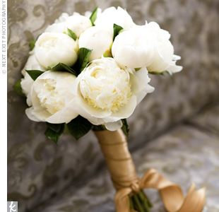 Bree's one request for the couple's wedding date? That it be during peony season. Her favorite flower made up her all-white bouquet, which was wrapped in gold ribbon.