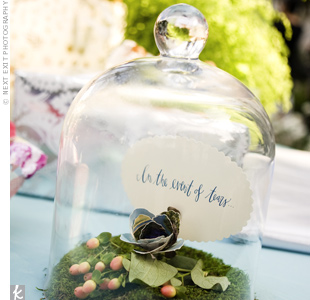 "A box filled with vintage hankies sat next to a bell jar with a sign inside that read, ""In the event of tears..."""